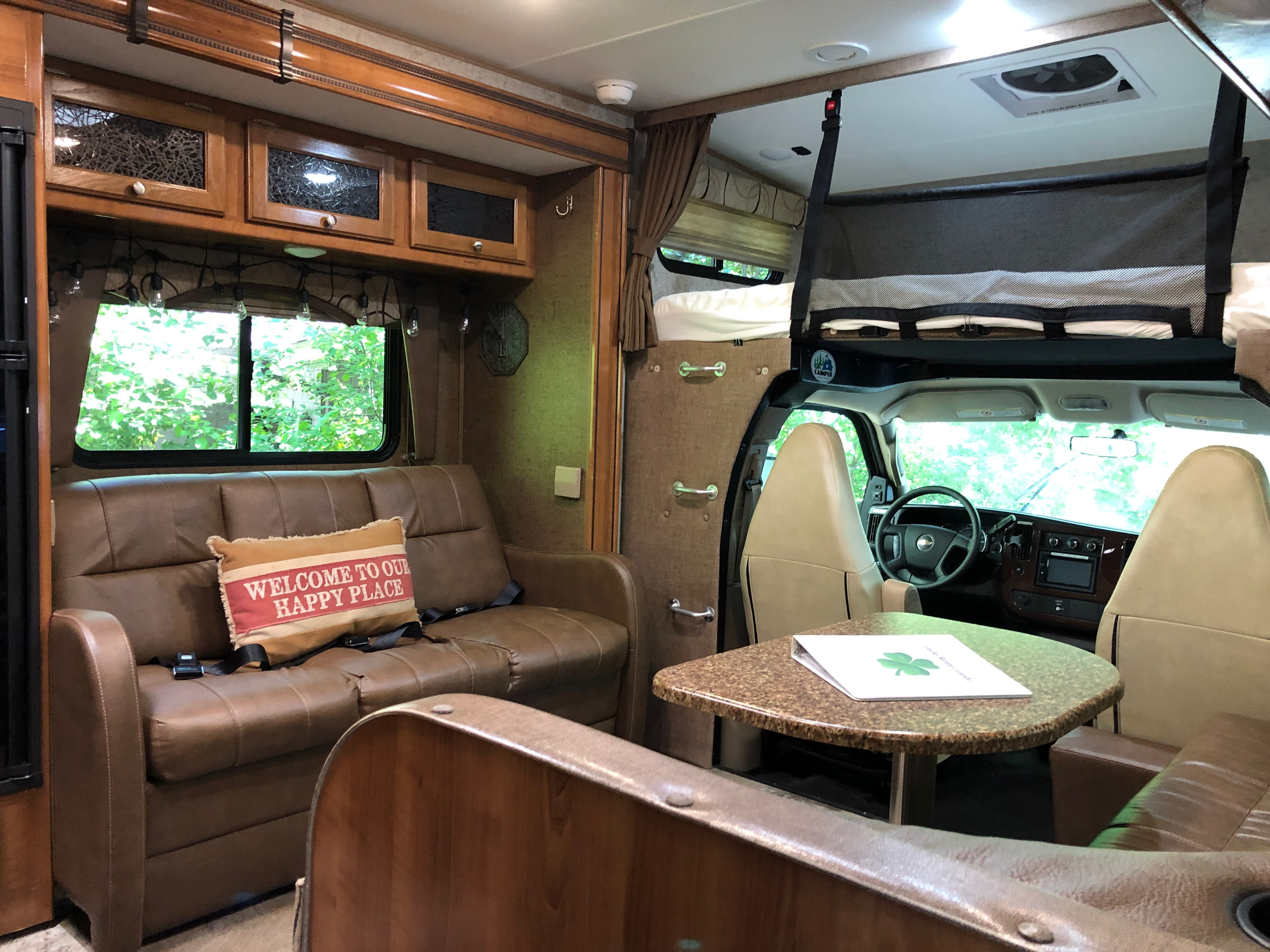 Open concept living and dining room!. Coachmen Leprechaun 2018