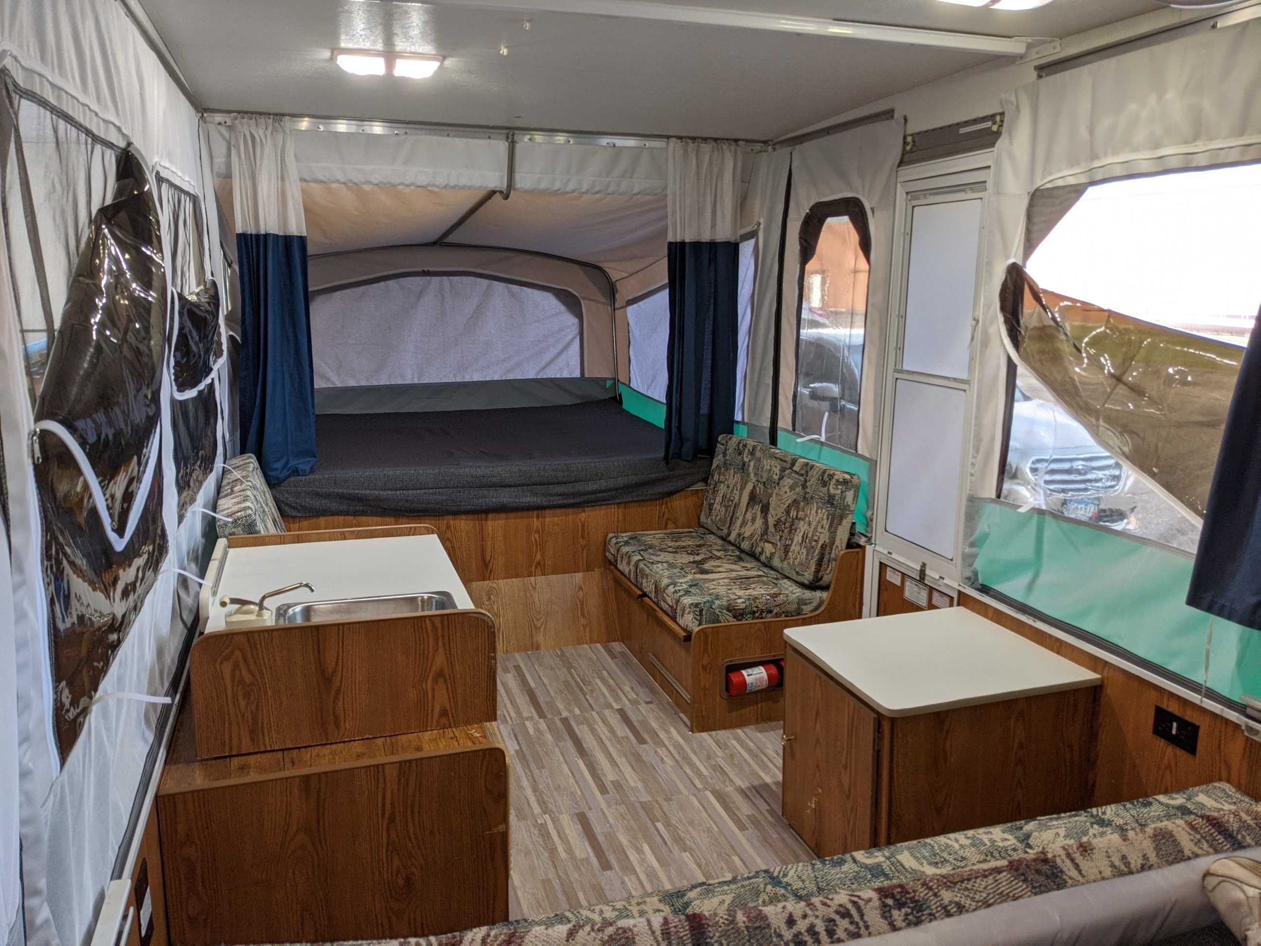 New flooring and new tent for 2021! The forward bunk is queen sized.. Dutchmen 1004D 1999