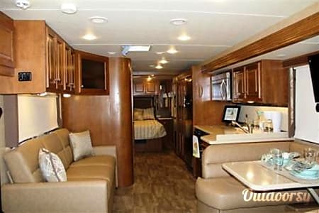 Roll like a rock star with an eye-catching Class A coach - accommodates 8!  Victor, NY