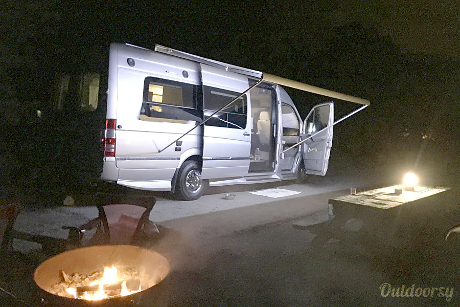 2016 Mercedes Sprinter Winnebago Era Solana Beach, CA Camping at night with 16ft. Awning out and Awning lights on.