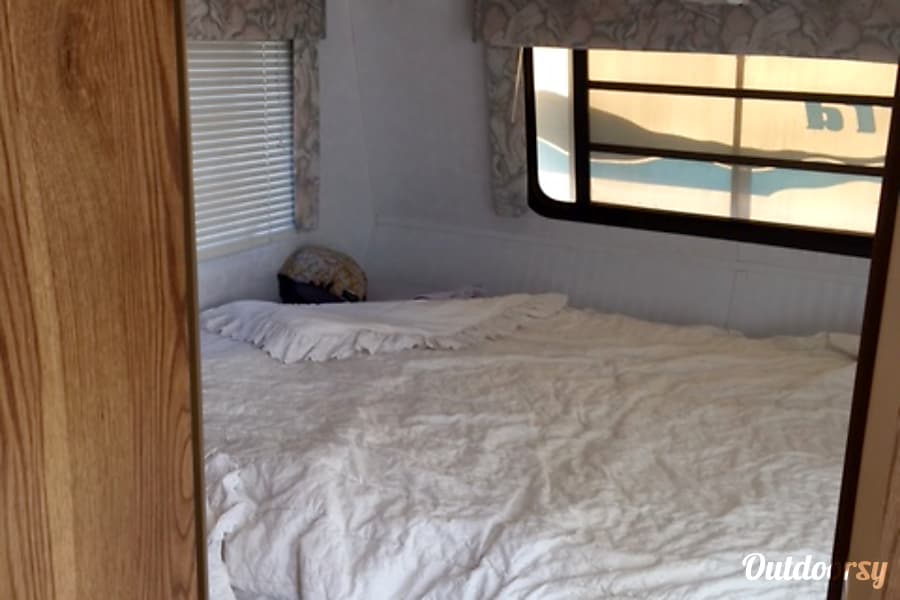 Perfect size trailer for outdoor fun Reno, NV Main bedroom queen size bed.