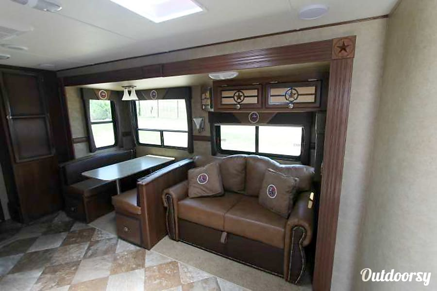 2015 CrossRoads LHT32QB15 Round Rock, TX Couch and dinette turn into beds for additional sleeping.