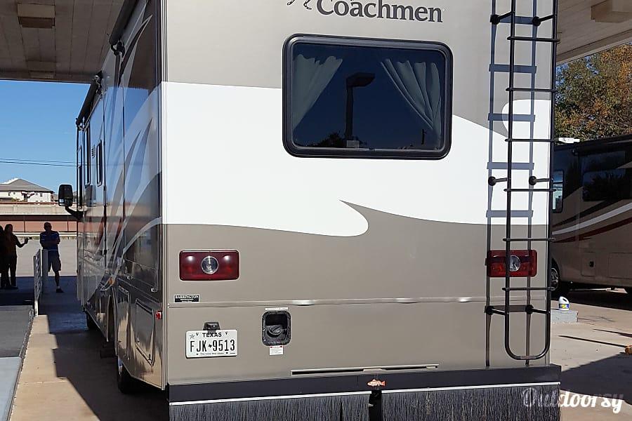 exterior 2013 Coachmen Pursuit #301 Austin, TX