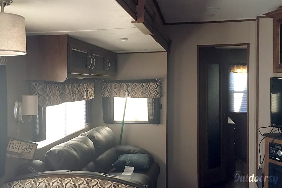 2016 Coachmen Chaparral Bray, OK Living room sofa folds out into a queen bed