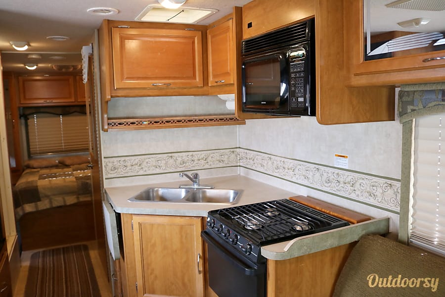 2006 Fleetwood Jamboree - Home Away from Home! Layton, UT Functional kitchen with attached additional counter space if needed. Stove, microwave, oven, kitchenware, pots/pans, dishes, and coffee pot included