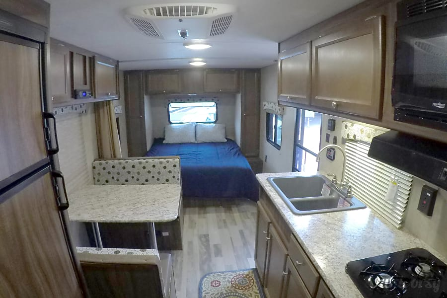 """2017 Coachman Clipper (21') - nicknamed """"Amarillo"""" Houston, TX The kitchen has a 3-burner stove, microwave, large refrigerator & freezer, deep double sink & all kinds of storage!"""