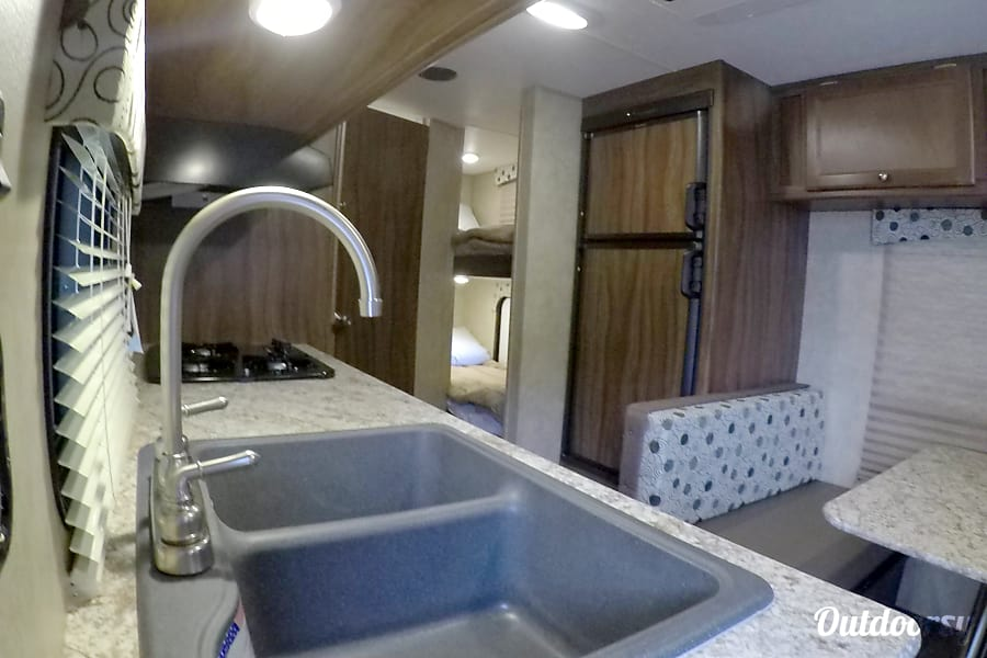 """2017 Coachman Clipper (21') - nicknamed """"Amarillo"""" Houston, TX Bunk beds are comfy, private and both have their own overhead light feature to allow for reading, games, etc."""