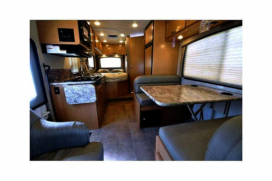 2016 Thor Motor Coach Chateau Buena Park, CA Living Room/Kitchen Area. Table Drops Down as a bed as well
