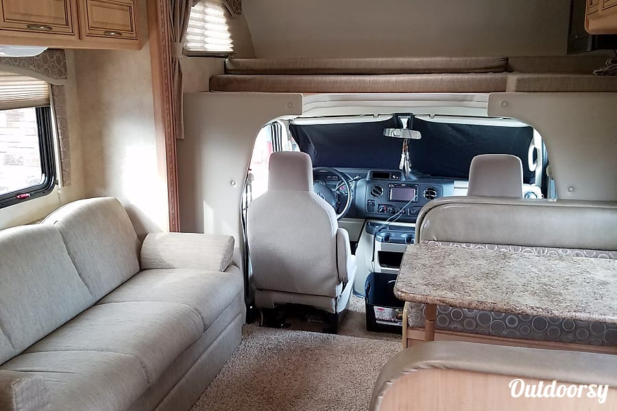 2011 Thor Motor Coach Chateau Moab, UT Couch & Table fold to a bed as well as the bed above the cab.