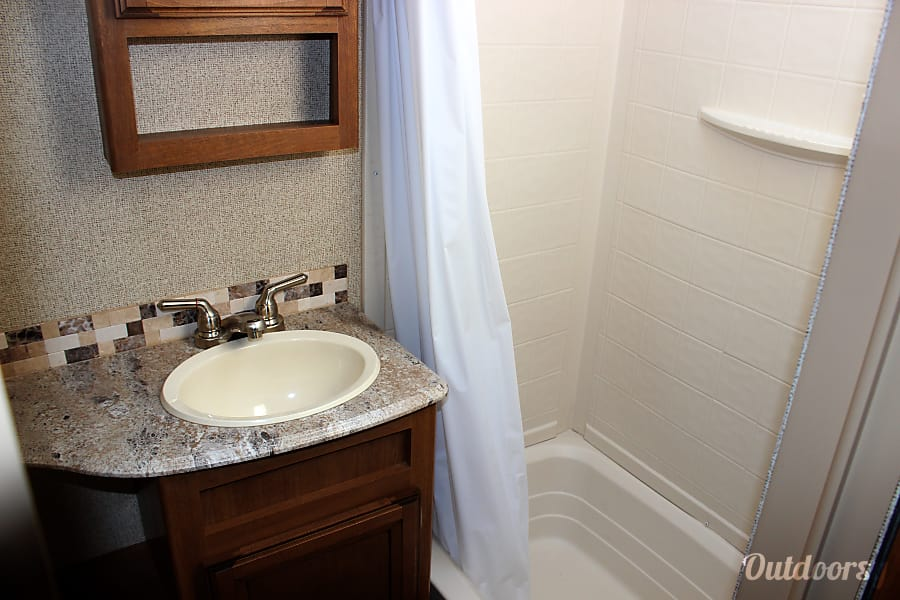 2017 Coachmen Apex Holly Springs, NC Shower with a tub.  Perfect for giving the little ones a bath.