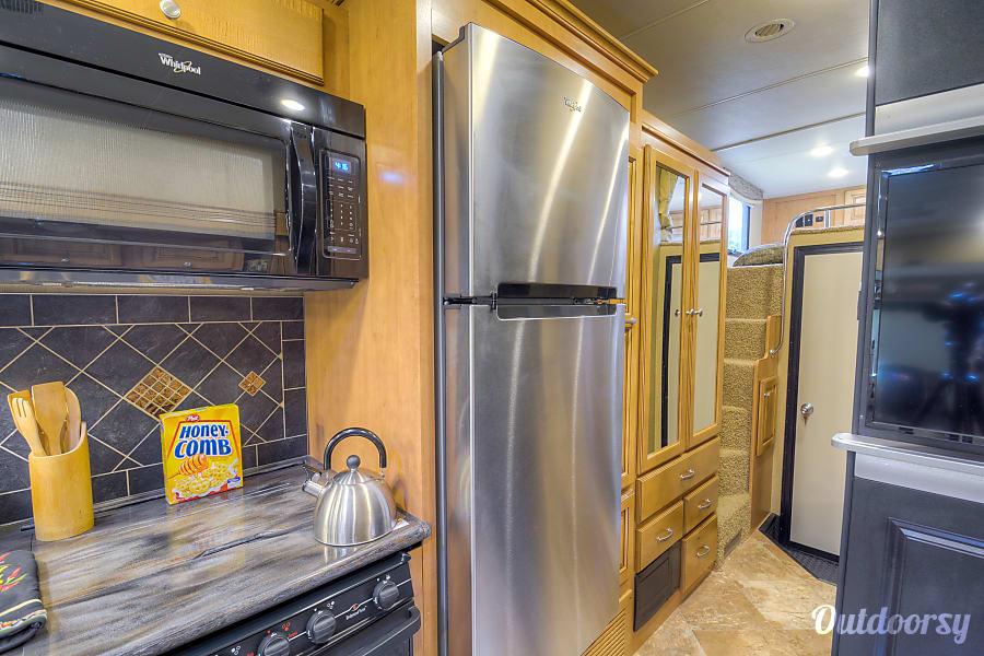2016 Thor Motor Coach Outlaw Toy Hauler Chesapeake, VA Household Refrigerator, and freezer with ice maker.