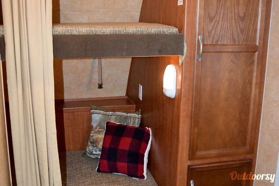 2011 Jayco Jay Feather Select Prior Lake, MN Bunk area in front with two twins.  Curtain to provide privacy.  Lower bunk folds up to allow for extra storage.  Great area to store bikes or other recreational/camping equipment. Also pictured,  large storage closet with rack to hang clothes.