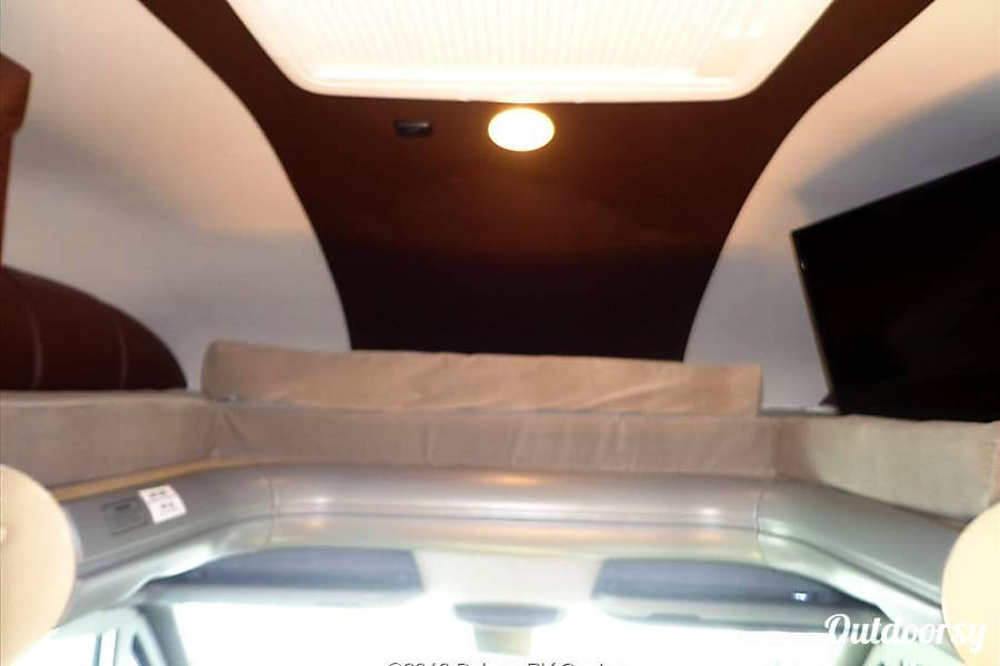 2009 Coachmen Prism Deptford Township, NJ Over head bunk with separate light control and tv in bunk area viewable from main seating area or from bunk.