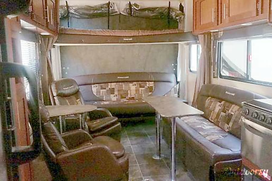 2014 Forest River Sandstorm Toy Hauler Washington, UT Electric bunk bed on top, two couches fold out to beds.
