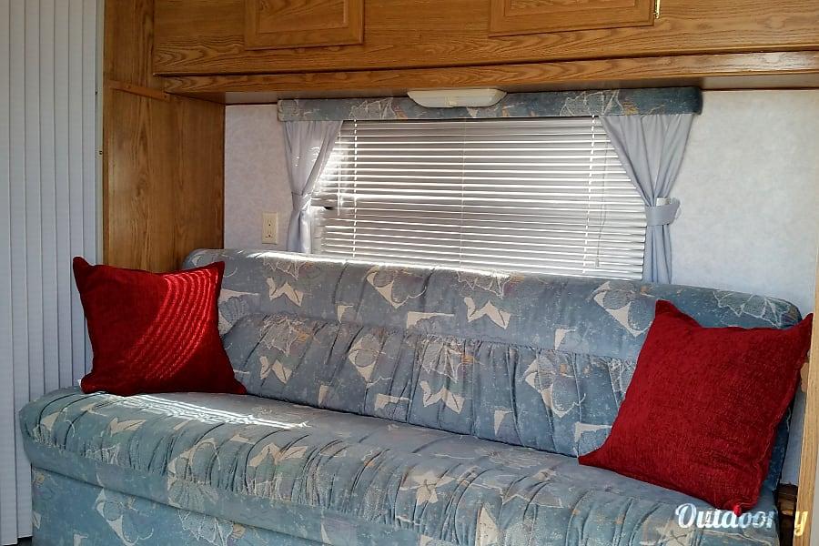 1996 Fleetwood Wilderness Eaton, CO Convertible sofa that sleeps two.