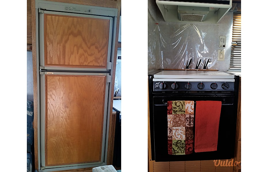 1996 Fleetwood Wilderness Eaton, CO 4 burner gas stove and oven and 8 cubic foot fridge/freezer works on propane or electric - always have cold food!