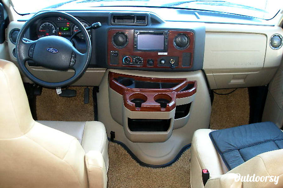 BG5940 2012 Coachmen Concord Riverside, MO Close-up of cockpit with backup monitor