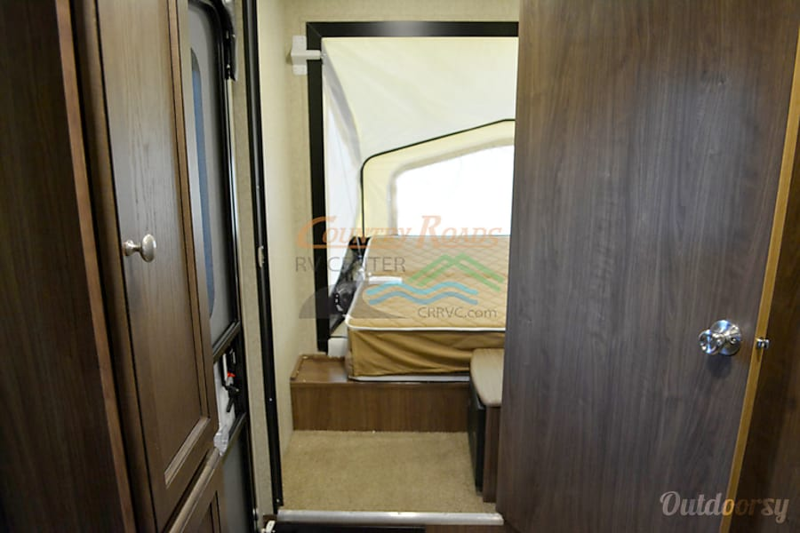 2015 Palomino Solaire Ultra Lite Hybrid- Best Experience Waxahachie, TX Entrance to canvas bed and it's own privacy door.