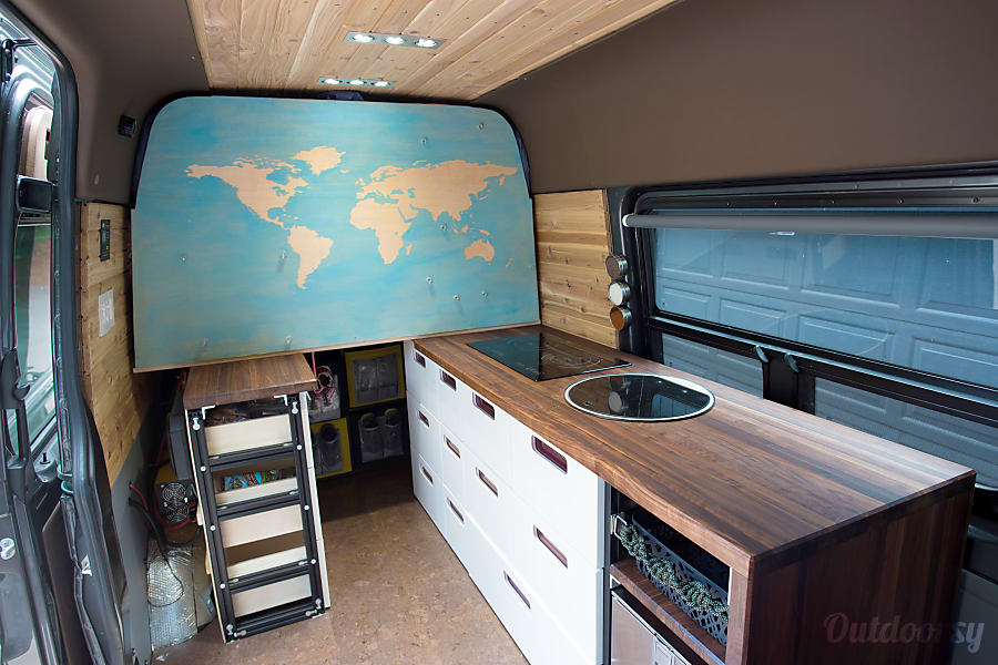 2016 4x4 Mercedes-Benz Sprinter RV Portland, OR Map folds down, revealing the bed system.