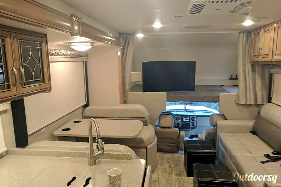 2017 Thor Motor Coach Four Winds Centennial, CO Large bed over cab, large TV with DVD player, couch seats three comfortably. Seat Belts for 7 people.