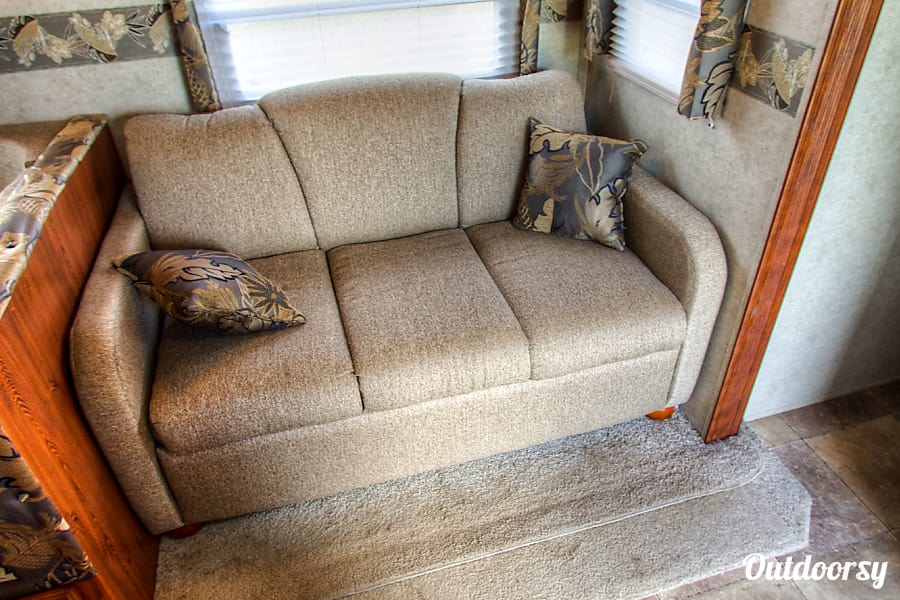 2012 Forest River Rockwood Signature Ultra Franklin, TN Living room couch pulls out into a full size bed.