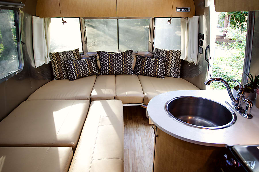 2017 Airstream Flying Cloud Dallas, TX Tabel folds down and sofa pulls out for additional sleeping or lounging space in the front.