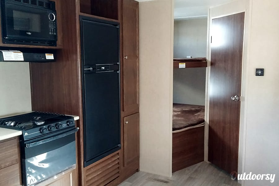 2016 Dutchmen Coleman Spearfish, SD Kitchen prep area and double bunkbeds