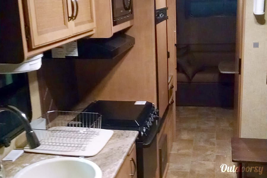 2015 Thor Motor Coach Axis Paris, IL There is a slideout in the kitchen area.