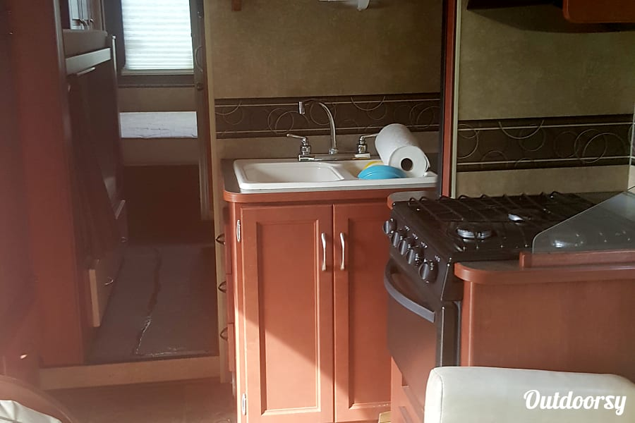 2015 Winnebago Minnie Winnie Issaquah, WA View of kitchen without slider expanded from living room