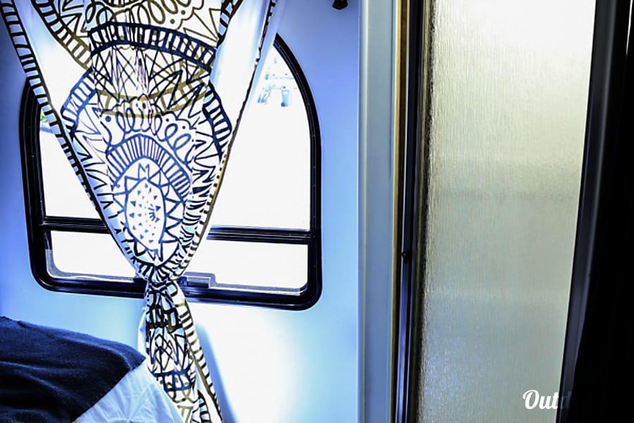 Glampin in Gloria Morro Bay, California Bedroom window & Glass Shower