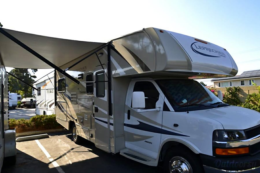 The fabulous Leprechaun Huntington Beach, California Electric awning, out door LED lights on front of RV, porch light as well.