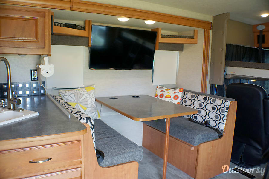"2016 Itasca Sunstar Port St. Lucie, FL Dinette and 37"" lcd tv, dinette turns into a sleeper and can accommodate carseats"