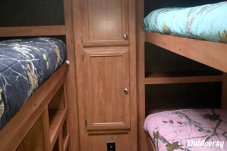 The Oasis Camp Verde, AZ Three bunks beds and lots of space to keep belongings in
