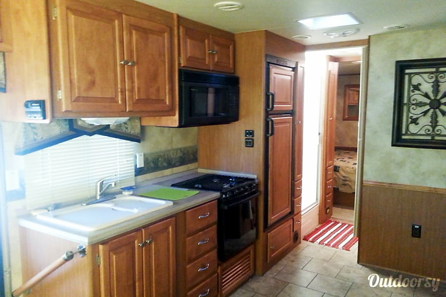 Many Happy Adventures - 32 Footer - Sleeps 4 Adults + 2 Kids Tucson, AZ Nice, Big Kitchen Area. Lots of Cabinet Storage. Includes Microwave Oven, Gas Oven and Refrigerator/Freezer.
