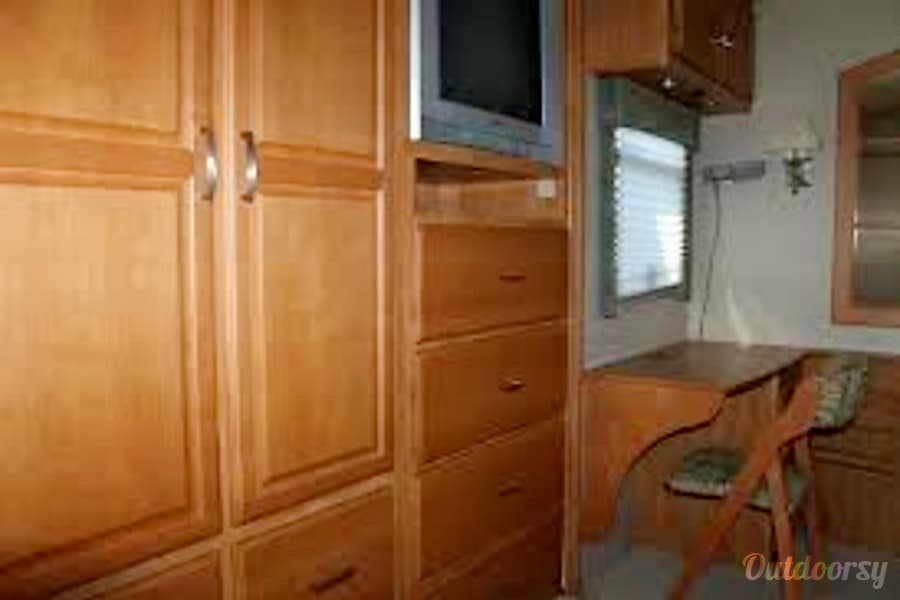 2007 Winnebago Adventurer Phoenix, Arizona Desk, TV and wardrobe area in back bedroom.  Queen Bed.