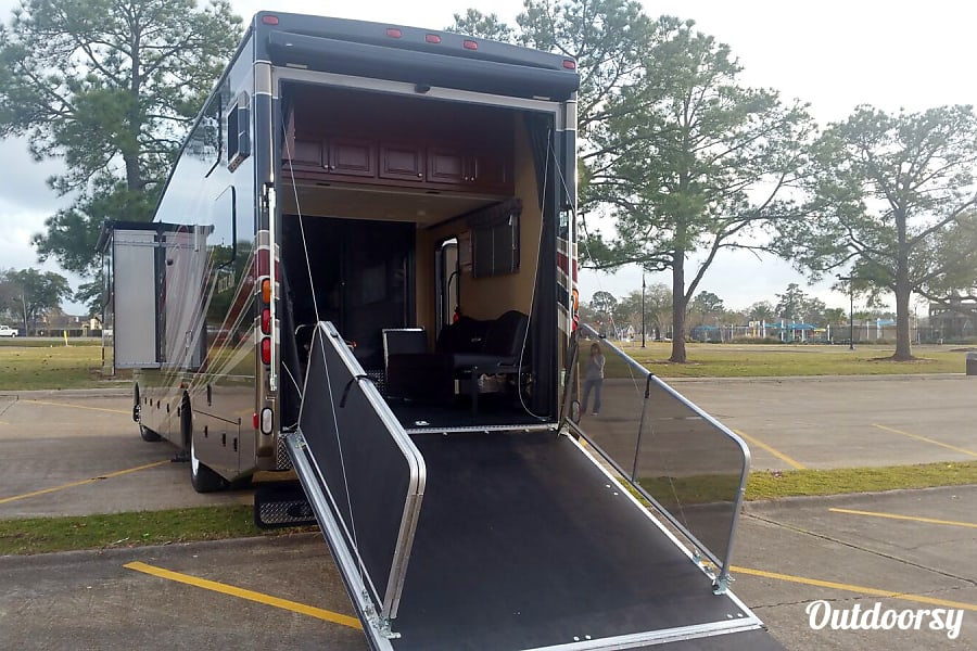 2016 Thor Motor Coach Outlaw Dallas, TX We have a little golf cart we drive right up in there. (not included)  The back gate can be used as a porch. However, we did remove those silver railings because it made getting the thing set up in either ramp or porch position only take about 30 seconds.