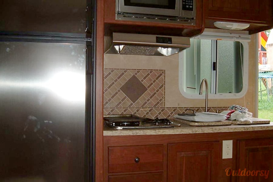 2011 Cruiser Rv Corp Fun Finder Xtra Arnold, MD kitchen....fridge,3 burner stove and double sink