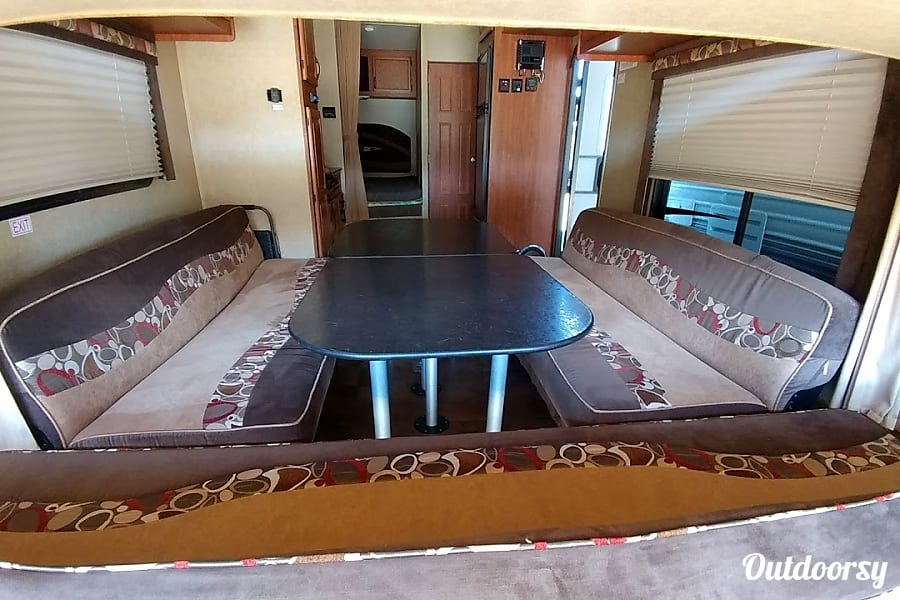 2014 Jayco Octane Prescott Valley, AZ With dining table and seats set up.  Couches fold down into beds.