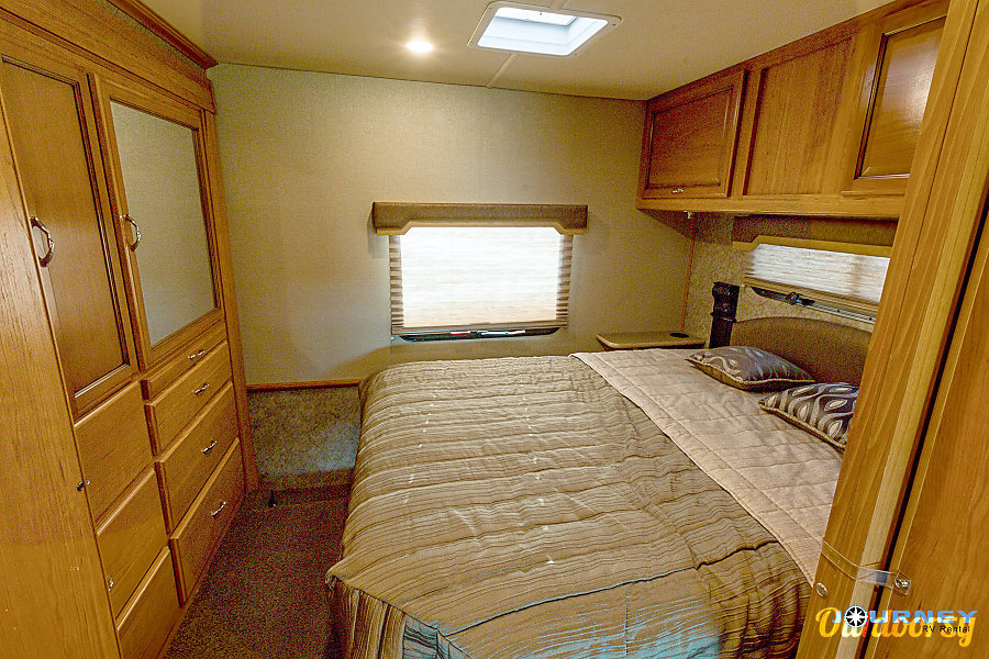 Fleetwood Storm - 32' Class A With Bunks Riverview, FL Master bedroom with ample cabinet storage
