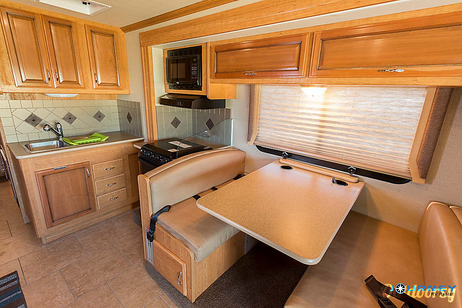 Fleetwood Storm - 32' Class A With Bunks Riverview, FL Kitchen area and Dinette which turns into a Full bed