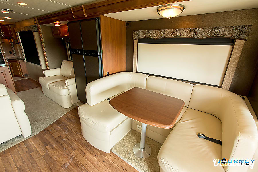 Holiday Rambler Vacationer - 36' Class A Riverview, FL Refrigerator and Dinette area which turns into Full bed