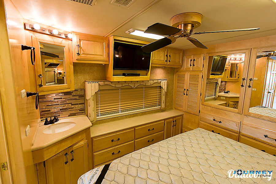 American Tradition - 40' Class A Diesel Riverview, FL Master bedroom with vanity