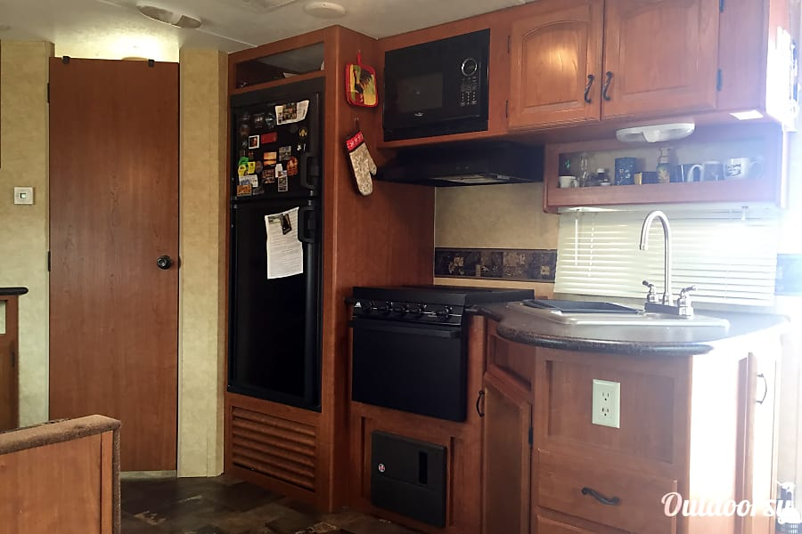 "2013 Forest River Prime Time Tracer!! Ultimate adventure ""Glamping"" Virginia Beach, VA Kitchen complete with microwave, stove, oven and fridge. Double sink."