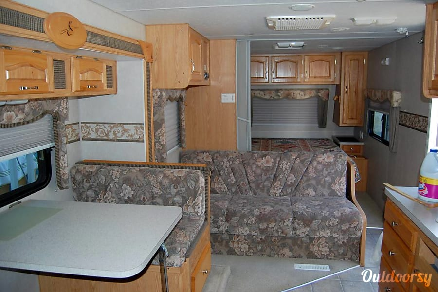 Arctic Fox:  Comfort / Great layout / Built tough / Easy Tow / Solar / Delivery Available Folsom, CA Great Living space, great floor plan with slide in or out.  Makes for easy bathroom breaks and access without having to slide out to get around.