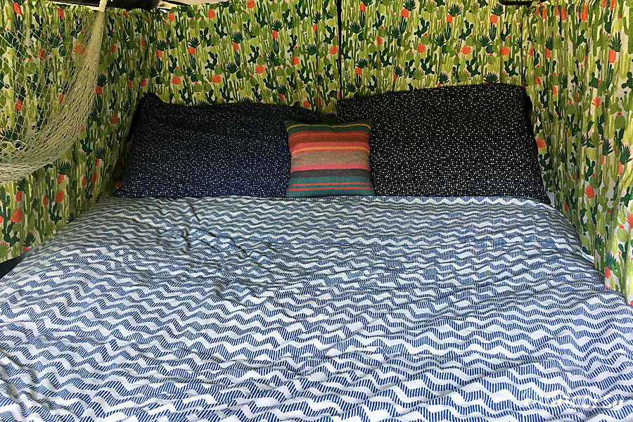 Funky Cozy 1999 chevy astrovan Pacific Grove, California This is the bed made up with blackout curtains.
