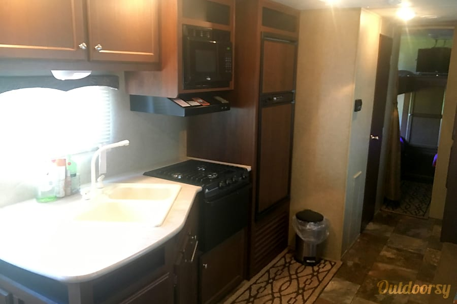 2015 Jayco Jay Flight Mount Juliet, TN Full kitchen.  Double sink, microwave, fridge with separate freezer, three burner gas cooktop and gas oven.  Also have crockpot, toaster, coffee pot, griddle, and electric skillet.