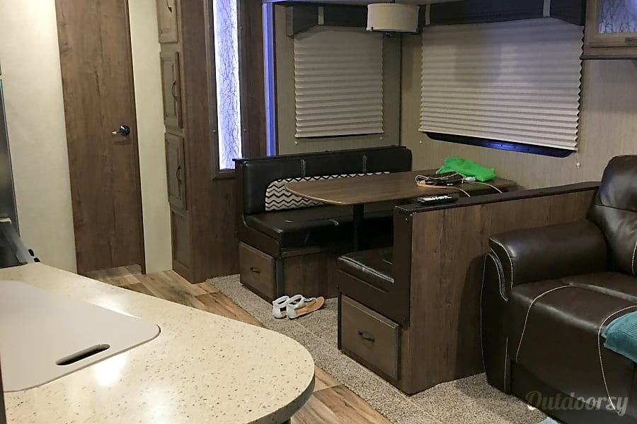 2016 Cruiser Rv Corp Radiance Biloxi, MS Leather love seat, booth dining seats 4 and kitchen to left