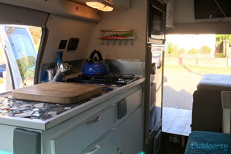 """Meet """"Atlas""""  1992 Ford Camper Van Coachman Pismo Beach, CA View through van with back doors open"""