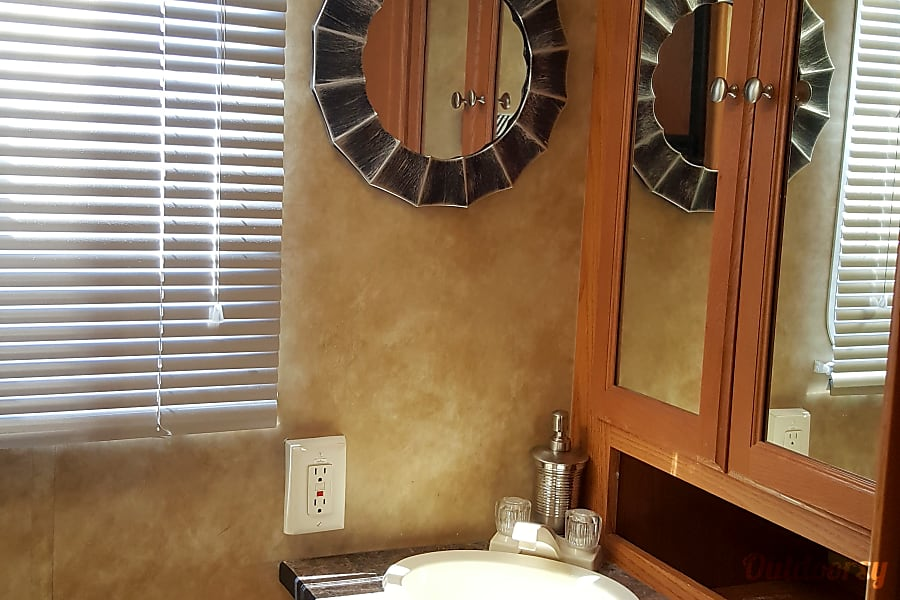 Rent North Trail 21FBS With Slide Out No Mileage Charge Las Vegas, NV Full bath with sink, toilet, beautiful glass shower and toilet.