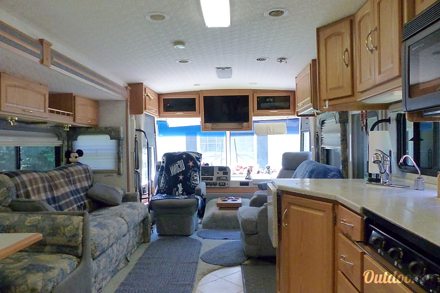 2004 Itasca Suncruiser Efland, NC Looking from kitchen toward front of RV with slide out.